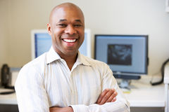 Portrait Of Male Obstetrician In Hospital. Portrait Of Happy Male Obstetrician In Hospital Smiling To Camera Stock Image