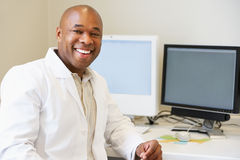 Portrait Of Male Obstetrician In Hospital. Smiling At Camera Royalty Free Stock Photo