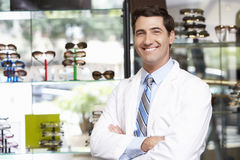 Portrait Of Male Optician By Glasses Display Royalty Free Stock Photography