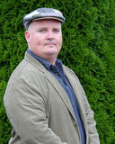 Portrait of a male outside in jacket and tweed hat. Photo portrait of a male outside in jacket and tweed hat Royalty Free Stock Photography
