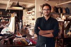 Portrait Of Male Owner Standing In Gift Store Stock Photography