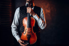 Portrait of male person holding wooden violin Stock Images