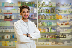 Portrait of a male pharmacist at pharmacy Stock Photos