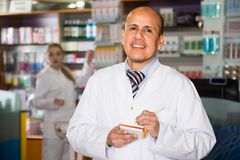 Male pharmacists working in farmacy. Portrait of male pharmacists working in modern drugshop Royalty Free Stock Images