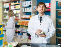 Portrait of male pharmacists working in modern farmacy Stock Photo