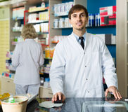 Portrait of male pharmacists working in modern farmacy Stock Image