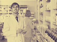 Portrait of male pharmacists working in modern farmacy Royalty Free Stock Image
