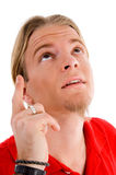 Portrait of male pointing upward Royalty Free Stock Photo