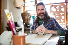 Portrait of male potter molding clay Stock Photography
