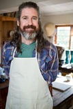 Portrait of male potter standing in pottery workshop Stock Photography