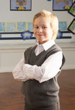 Portrait Of Male Primary School Pupil Standing In Royalty Free Stock Photo