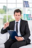 Portrait of male psychologist in his office Royalty Free Stock Photo