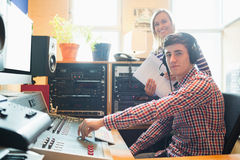Portrait of male radio host using sound mixer Royalty Free Stock Images