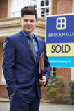 Portrait Of Male Realtor Standing Outside Residential Property Royalty Free Stock Photography