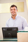 Portrait Of Male Receptionist At Hotel Front Desk Stock Photos