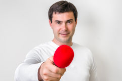 Portrait of male reporter with red microphone. Journalism and broadcasting concept Royalty Free Stock Photography