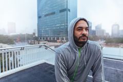 Portrait of a male runner in hooded sweatshirt Stock Image