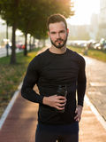 Portrait Of Male Runner On Urban Street Stock Photo