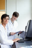 Portrait of male scientists with a monitor Royalty Free Stock Photo