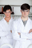 Portrait of male scientists posing. In a laboratory Stock Image