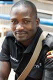 Male security guard, Kampala, Uganda. Portrait of a male security guard on duty and in uniform, Kampala, Uganda stock photo