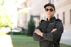 Male security guard in uniform outdoors. Portrait of male security guard in uniform outdoors Royalty Free Stock Image
