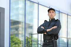 Portrait of handsome male security guard in uniform outdoors. Portrait of male security guard in uniform outdoors Royalty Free Stock Photos