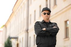 Portrait of male security guard in uniform. Outdoors Royalty Free Stock Images