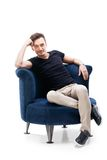 Portrait of a male  sitting on chair Stock Images