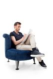 Portrait of a male  sitting on chair Stock Image