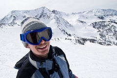 Portrait of a male skier. Smiling male skier with the Rockies in the background Stock Images