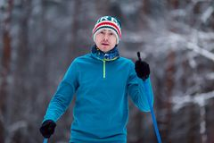 Portrait of male skier on blurred background. In winter forest Stock Images