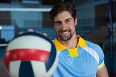 Portrait of man with volleyball Royalty Free Stock Photography