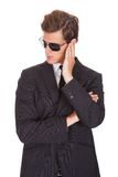Portrait of male spy. Wearing Sunglasses Isolated On White Background Royalty Free Stock Photography
