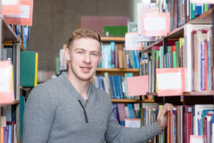 Portrait male student in library Royalty Free Stock Photos