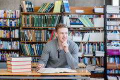 Portrait male student in a library Royalty Free Stock Photos