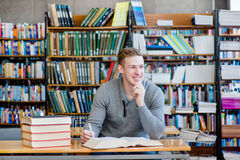 Portrait male student in a library.  Royalty Free Stock Images