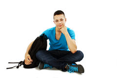A portrait of a male student with a school bag Royalty Free Stock Images