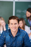 Portrait Of Male Student Smiling In Classroom Stock Image