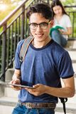 Portrait male student stand holding tablet computer Stock Images