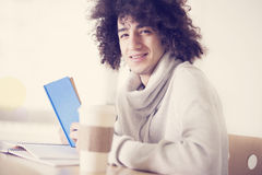 Portrait of male student studying at table. Indoors Stock Photos