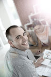 Portrait of a male student working. Portrait of smiling college student Royalty Free Stock Photo