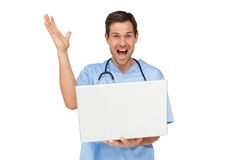 Portrait of a male surgeon with laptop shouting Royalty Free Stock Images