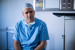 Portrait of male surgeon sitting on a chair Stock Image