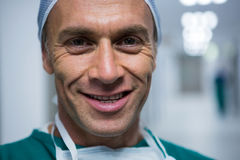 Portrait of male surgeon. Smiling in hospital Stock Images