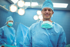 Portrait of male surgeon smiling in operation theater. At hospital Royalty Free Stock Photography