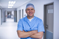 Portrait of male surgeon standing with arms crossed. At the hospital Royalty Free Stock Image