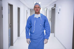 Portrait of male surgeon standing in corridor. At hospital Stock Photos