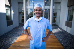 Portrait of male surgeon standing with hands on hip Royalty Free Stock Photography