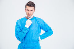 Portrait of a male surgeon. Standing isolated on a white backgorund and looking at camera Stock Photography